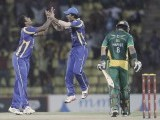 Thisara Perera (L) celebrates with Dinesh Chandimal taking the wicket of Pakistan's Mohammad Hafeez (8). PHOTO : REUTERS