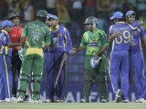 Sri Lanka's cricket team players shake hands with Pakistan's Sarfraz Ahmed (3rd R) and Rahat Ali (90) after winning their second One Day International (ODI) cricket match against Pakistan, in Pallekele. PHOTO: REUTERS