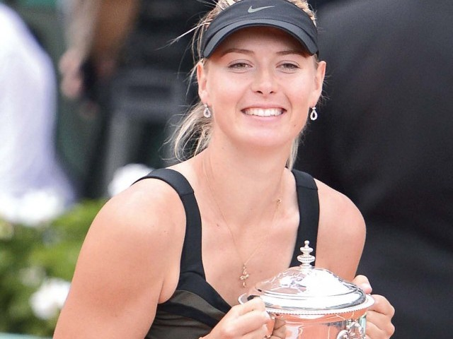 Maria Sharapova completed her Grand Slam and became the highest-earning sportswoman on earth with the French Open triumph. PHOTO: AFP