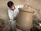 A potter busy designing a pot on a potter's wheel. PHOTO: MUHAMMAD IQBAL/ THE EXPRESS TRIBUNE