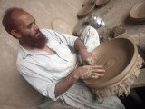 A potter designing a clay dish. PHOTO: MUHAMMAD IQBAL/ THE EXPRESS TRIBUNE