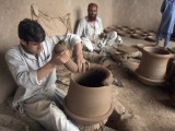 Potters busy shaping blocks of clay. PHOTO:  MUHAMMAD IQBAL/  THE EXPRESS TRIBUNE