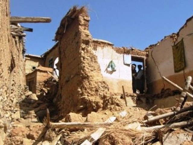 A double earthquake triggered a landslide that buried homes in northern Afghanistan. PHOTO: AFP