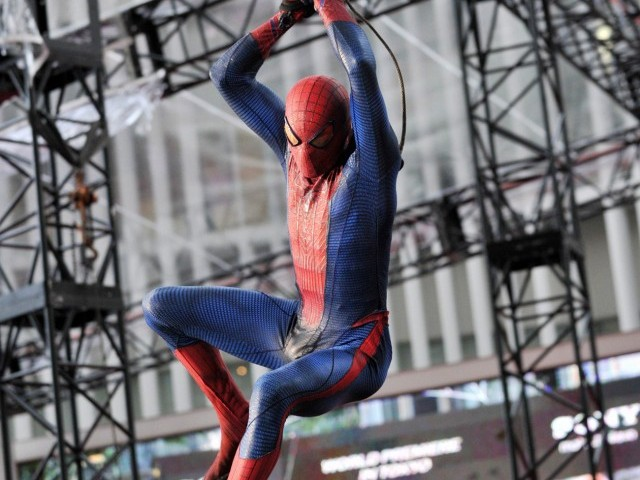 "A stuntman in a spiderman costume swings through the air at the world premiere of ""The Amazing Spider-man"" in Tokyo on June 13, 2012. Cast members attended the premiere of the latest spiderman movie. PHOTO : AFP"