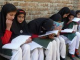 girls-read-at-a-school-after-schools-reopened-in-swat-valley