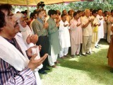 Mourners pray for Mehdi Hassan's forgiveness during his absentia funeral procession in Lahore. PHOTO: NNI