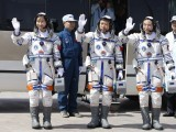 Chinese astronauts Jing Haipeng (R), Liu Wang (C) and Liu Yang, China's first female astronaut, wave as they leave for the launch tower during a departure ceremony at the Jiuquan Satellite Launch Center, Gansu province June 16, 2012. PHOTO: REUTERS