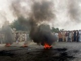 Protesters set tires on fire in Attock during a demonstration against loadshedding on Monday. PHOTO: INP