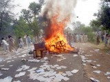 Protesters set furniture on fire during a demonstration against loadshedding in Sargodha. PHOTO: ISRARUL HAQ/ EXPRESS