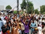 Local residents hold demonstration against loadshedding in Faisalabad. PHOTO: ONLINE