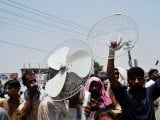 Local residents hold a demonstration against loadshedding in Faisalabad. PHOTO: ONLINE