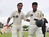 Mohammad Hafeez (L) and teammate Azhar Ali (R) leave the ground at the end of the first day of the second Test match between Sri Lanka and Pakistan at the Sinhalease Sports Club (SSC) Ground in Colombo on June 30, 2012.  PHOTO: AFP