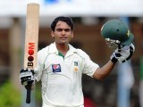 Mohammad Hafeez raises his bat and helmet in celebration after scoring a century (100 runs) during the first day of the second Test match between Sri Lanka and Pakistan at the Sinhalese Sports Club (SSC) Ground in Colombo on June 30, 2012. PHOTO: AFP