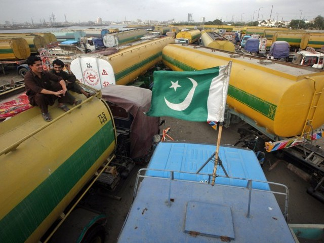 The containers are ready to transport oil and food supplies to Afghanistan from Karachi. PHOTO: REUTERS/FILE