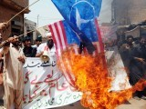 us-drone-attack-protest-us-flag