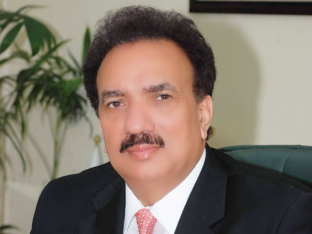 Rehman Malik, after being assured no military personnel were invited, signed the documents. PHOTO: FILE