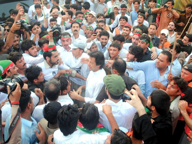 PTI supporters throng Imran Khan at the rally in Peshawar. PHOTO: MUHAMMAD IQBAL/EXPRESS