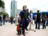 Pete Mendoza of Los Angeles, dressed as The Joker from the Batman movies, walks outside the exhibit halls at Comic-Con International in San Diego, California July 12, 2012. PHOTO: REUTERS