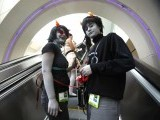 Attendees Delaney Oldenburg (L) and Sabrina Zaitz, who are wearing costumes inspired by the webcomic Homestuck, ride an escalator during Comic-Con international convention in San Diego, California July 13, 2012. PHOTO: REUTERS