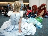 Girls wearing Cinderella (L), Ariel the Little Mermaid (R) and Minnie Mouse (3rd R) costumes sit on the floor during the Comic Con International convention in San Diego, California July 13, 2012. PHOTO: REUTERS