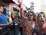 Fans participate in ''Zombie Walk: San Diego'' during Comic-Con International 2012 on July 13, 2012 in San Diego. PHOTO: AFP