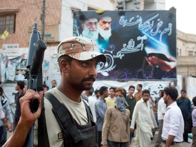 A Ranger official on duty at a rally against the ban of a Shia website. PHOTO: ONLINE