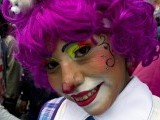 A clown smiles during a pilgrimage to the Virgin of Guadalupe's basilica, Mexico's patron saint, in Mexico City on July 18, 2012. PHOTO: AFP