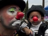 A clown and his son pose during a pilgrimage to the Virgin of Guadalupe's basilica, Mexico's patron saint, in Mexico City on July 18, 2012. PHOTO: AFP