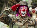 A clown in military clothes salutes as he takes part in the pilgrimage to the Virgin of Guadalupe's basilica, Mexico's patron saint, in Mexico City on July 18, 2012. PHOTO: AFP