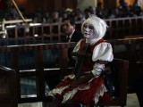 A clown attends a mass at the Basilica of Guadalupe in Mexico City July 18, 2012. Hundreds of clowns took part in the annual pilgrimage event, to thank the Virgin of Guadalupe for helping them find work through the year, according to local media. PHOTO: REUTERS