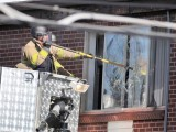 RAID: Police break the window of the apartment of James Holmes, the suspect of the shooting in the Aurora movie theatre. PHOTO: AFP