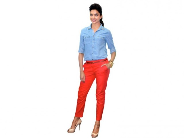 Deepika's faded denim shirt with stud details and orange-red ankle length pants from Zara looked absolutely fabulous.