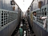A passenger looks through the window of a train as he waits for electricity to be restored at a railway station in New Delhi July 31, 2012. PHOTO: REUTERS