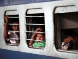 Passengers sit in a train as they wait for electricity to be restored at a railway station in New Delhi July 31, 2012. Grid failure hit India for a second day on Tuesday, cutting power to hundreds of millions of people in the populous northern and eastern states including the capital Delhi and major cities such as Kolkata. PHOTO: REUTERS