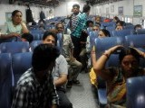 Indian passengers wait on a train during a power outage in New Delhi on July 31, 2012. A massive power failure hit India for the second day running as three regional power grids collapsed, blacking out more than half the country in a crisis affecting over 600 million people. PHOTO: AFP