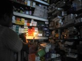 An Indian chemist holds a candle as he searches medicine at his shop during a power cut in Siliguri on July 31, 2012. A massive power failure hit India for the second day running as three regional power grids collapsed, blacking out more than half the country in a crisis affecting over 600 million people. PHOTO: AFP