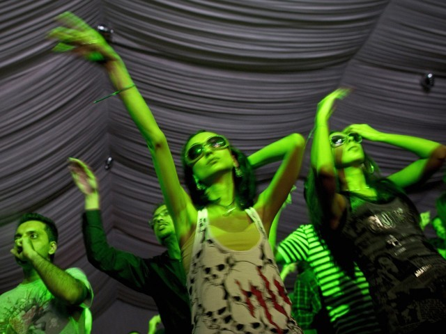 Pakistani youth dance during an electronic music showcase in Lahore early July 17, 2011. PHOTO : AFP/FILE