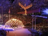 A flaming phoenix flies over the crowd coming out of the Olympic flame before being extinguished. PHOTO: REUTERS/FILE.