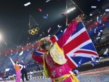 A performer watches the fireworks show at the closing ceremony of the London 2012 Olympic Games at the Olympic Stadium August 12, 2012.  PHOTO: REUTERS/FILE.