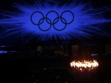 The Olympic Rings are seen behind the Olympic Torch during the closing ceremony of the London 2012 Olympic Games at the Olympic Stadium August 12, 2012. PHOTO: REUTERS/FILE.