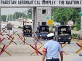 Police vehicles enter the Air Force base following a militant attack in Kamra, about 60 kilometres northwest of Islamabad, on August 16, 2012. PHOTO: AFP