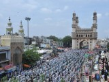 Indian Muslims offer Jumat-ul-Vida prayers on the last Friday of Ramazan outside the historic Mecca Masjid and near the Charminar monument (background) in Hyderabad on August 17, 2012, ahead of the Eid ul-Fitr festival. PHOTO: AFP