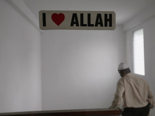 A sticker is seen on glass door at the Jama Masjid Mosque during the holy month of Ramazan in Panama City August 3, 2012. PHOTO: REUTERS