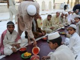 Pakistani youth arrange food before breaking their fast in Peshawar on July 21, 2102, on the first day of Muslims fasting month of Ramazan. PHOTO: AFP