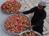 A Pakistani Muslim arranges fruit at a mosque in Karachi on July 21, 2102, on the first day of Muslims fasting month of Ramazan. PHOTO: AFP