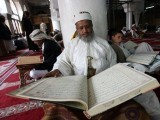A Yemeni man reads verses of the Quran, Islam's holy book, on the third day of the fasting month of Ramazan in the grand Mosque in the old city of Sanaa, on July 22, 2012. PHOTO: AFP