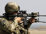 a-u-s-soldier-uses-the-scope-of-his-rifle-to-scan-areas-during-a-patrol-on-the-outskirts-of-jalalabad
