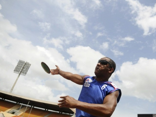 Dominican athlete Alfonso Olivero takes part in a discus training session at Olimpic Stadium Felix Sanchez in Santo Domingo, in preparation for the London 2012 Paralympic Games August 22, 2012. PHOTO: REUTERS