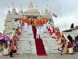 Torch bears pose for photographs outside the Shri Swaminarayan Mandir temple, as they carry the Paralympic flame during the torch relay in London August 29, 2012. PHOTO: REUTERS