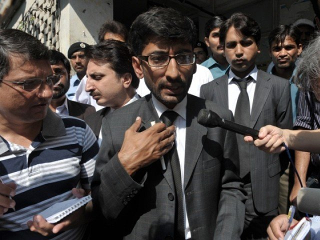 Rao Abdur Raheem, (C), the lawyer for the accuser of the Christian girl charged with blasphemy for allegedly burning papers of Quranic verses, talks with media outside the court in Islamabad on August 30, 2012. PHOTO: AFP